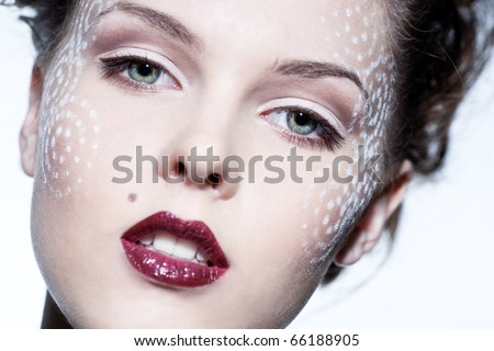Face of a beautiful woman with bright makeup