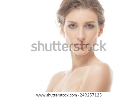 Face of a beautiful young brunette woman - stock photo