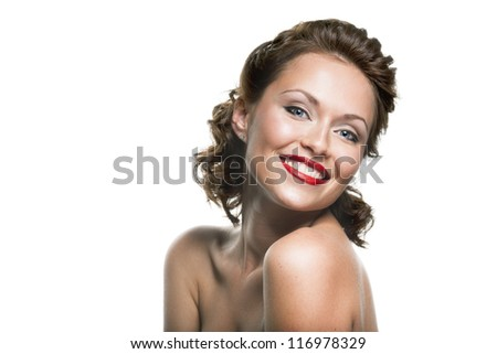 Face of a beautiful young brunette woman with bright makeup and curly hair - stock photo