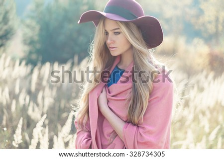 face of a beautiful young fashionable woman in a hat - stock photo