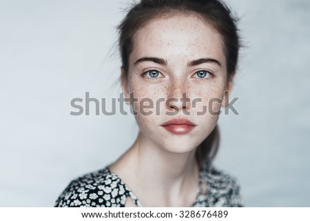 face of a beautiful young girl with a clean fresh face close up - stock photo