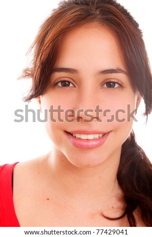Face of a beautiful young woman looking at the camera - stock photo