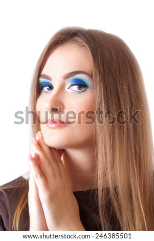 Face of a beautiful young woman with brightly blue eyes - stock photo