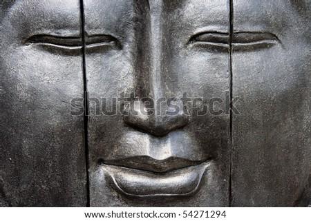 Face of a buddha - stock photo