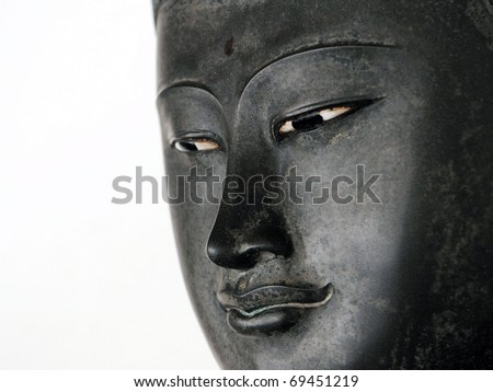 Face of a Buddha Statue Isolated on a White Background with Plenty of Copy Space - stock photo