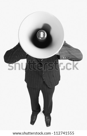 Face of a businessman coverd by a megaphone
