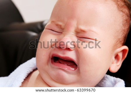 Face of a crying baby. People image - stock photo
