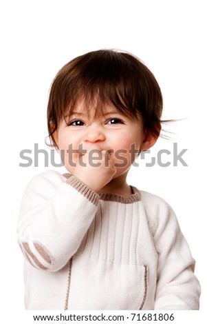 Face of a cute adorable baby infant toddler with innocent mischievous naughty expression, isolated. - stock photo