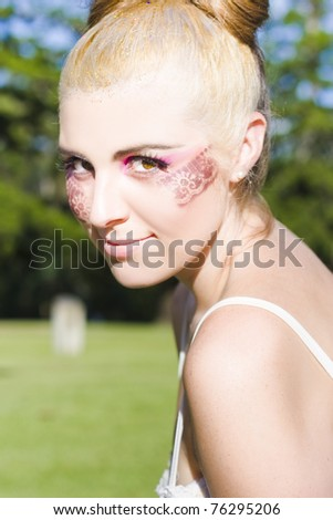 Face Of A Glamorous Fashionable And Stylish Dancing Ballerina Wearing Lace Design Cosmetics And Makeup Outdoors During A Youthful Recreation Dance Show - stock photo