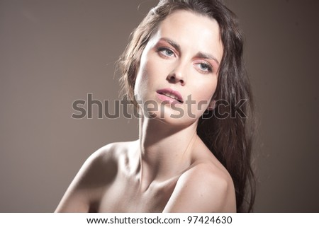 Face of a sexy young caucasian woman with natural makeup - stock photo