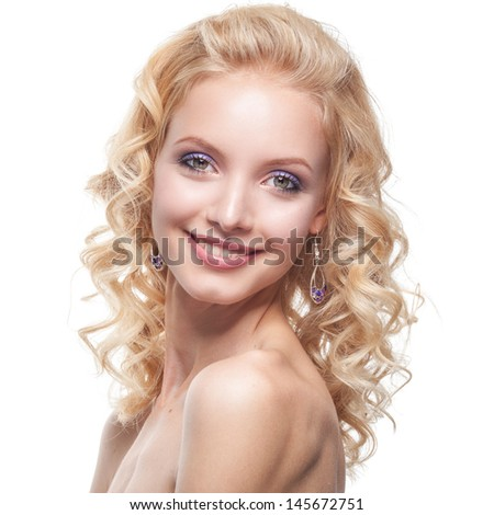 Face of a smiling young caucasian woman with curly blond hair  - stock photo