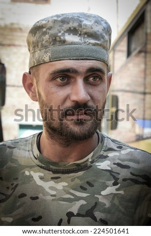 Face of a soldier - stock photo
