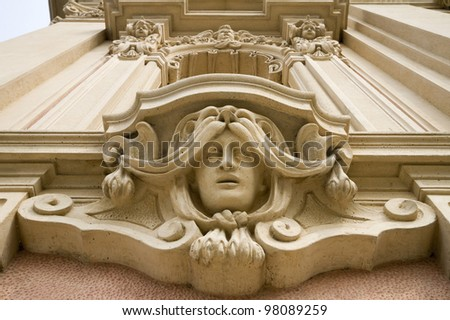 face of a woman on the face of brunate church