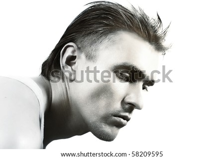 Face of a young handsome man with a stylish haircut and silver makeup