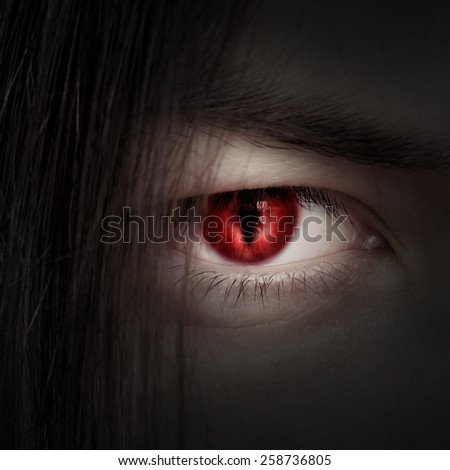 face of a young male vampire close up - stock photo