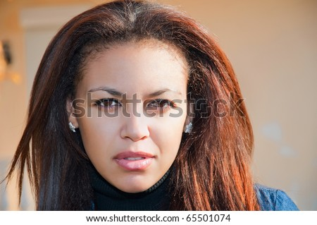 face of a young mulatto woman close-up, beautiful almond eyes - stock photo