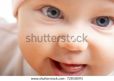 Face of adorable baby looking at camera - stock photo