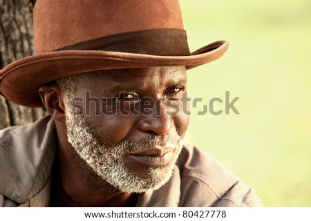 Face of an African American Homeless Man Outdoors - stock photo