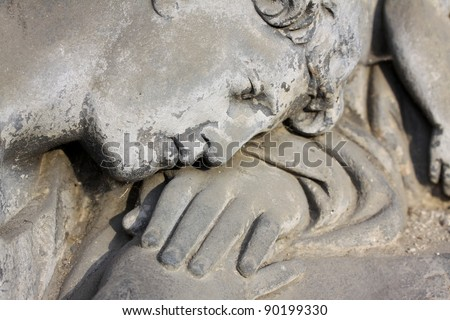 Face of Angel on the old Prague Cemetery - stock photo
