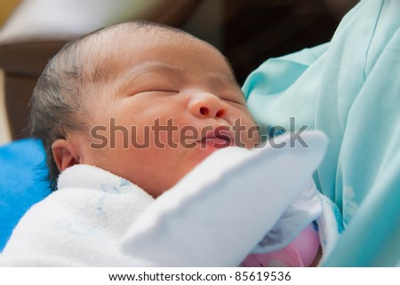 Face of Asian female newborn 2 days old fall asleep - stock photo