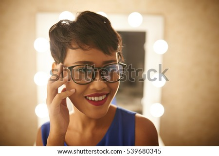 Face of attractive Asian woman in glasses
