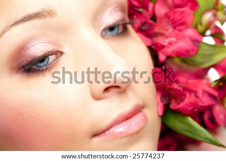 Face of attractive young woman with flowers