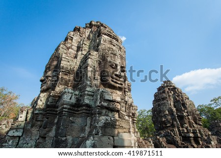 Face of Bayon Temple and Blue Sky