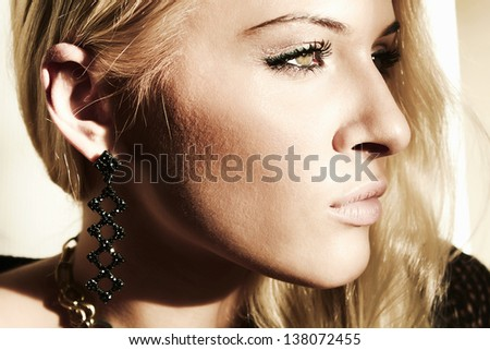 Face of beautiful blond woman in daylight
