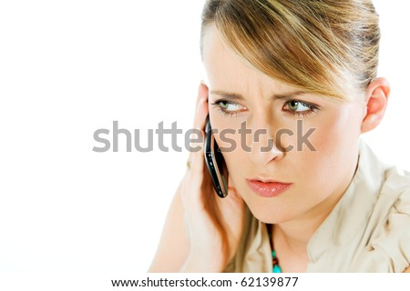 face of beautiful blond woman talking on the phone, looking worried - stock photo