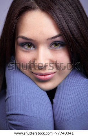Face of beautiful cute young woman (close-up portrait)