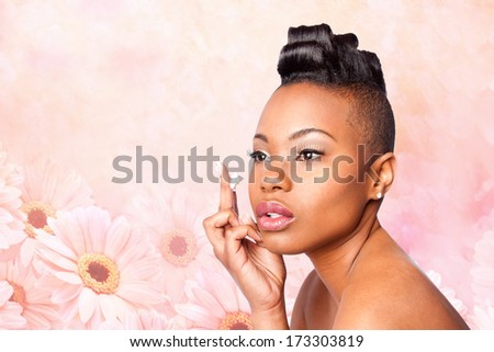Face of beautiful woman applying facial moisturizer exfoliating anti wrinkle aging cream under eyes, skincare concept, on pink flowers. - stock photo