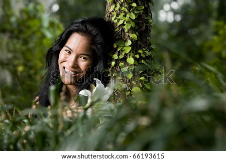 Face of beautiful woman of Pacific Islander ethnicity, 20 years, in the woods