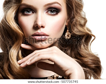 Face of  beautiful woman with long  brown  hair posing on white background