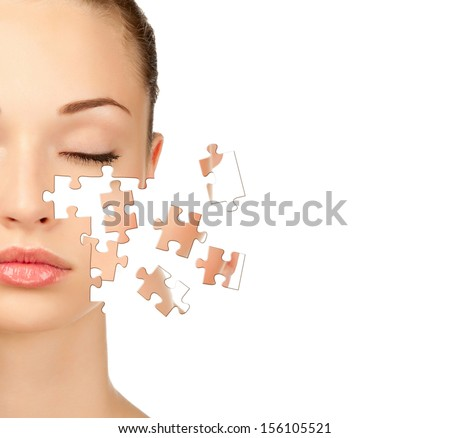 Face of  beautiful young woman with a puzzle collage of her skin, isolated on a white background - stock photo