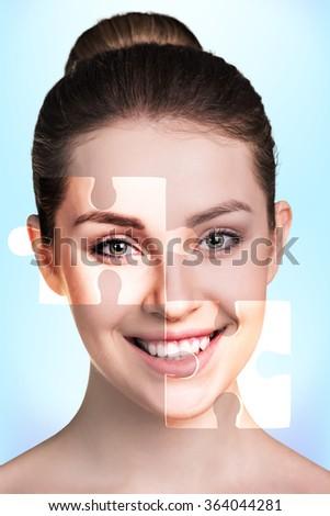 Face of  beautiful young woman with a puzzle parts - stock photo