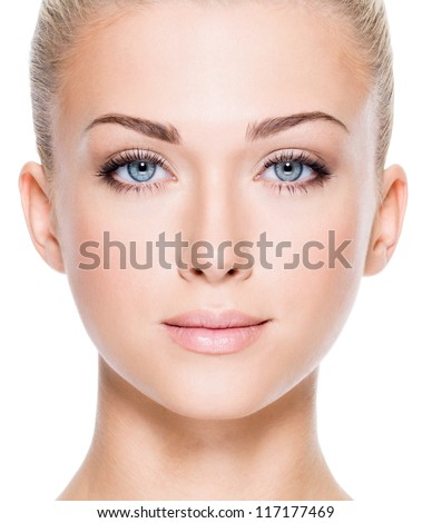 Face of beautiful young woman with beautiful blue eyes  - Closeup image on white background - stock photo