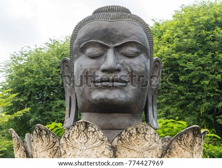 Face of Black Ancient buddha statue used as amulets of buddhism religion , Ayutthaya province , Thailand.