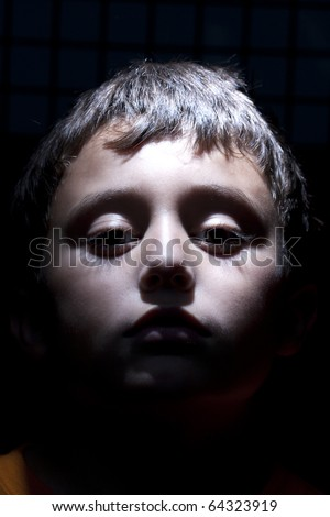 face of  boy in shadow - stock photo