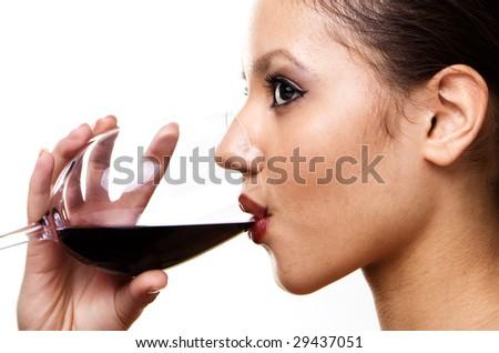 face of brunette girl drinking red wine - stock photo