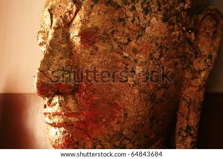 Face of Buddha isolated. - stock photo