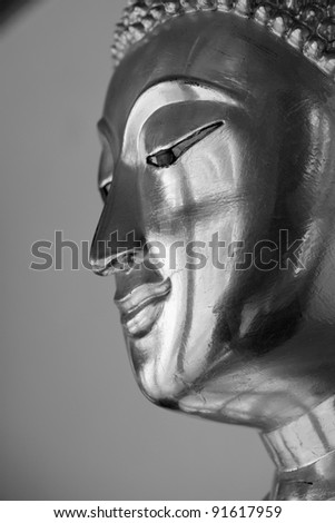 Face of buddha statue, black and white