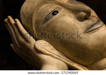 Face of Buddha statue reclining on hand at Sai Thai Temple in Krabi province in southern Thailand - stock photo
