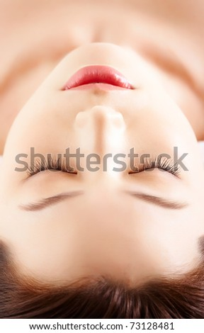 Face of calm female before procedure of facial massage - stock photo