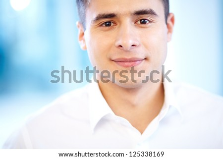 Face of cheerful businessman looking at camera with smile - stock photo