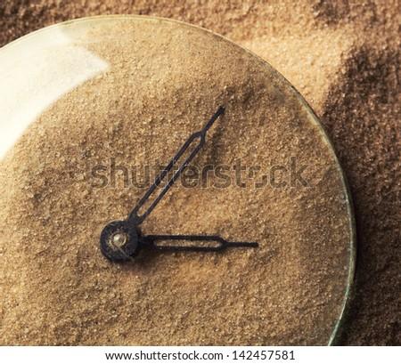 Face of clock full of sand - stock photo
