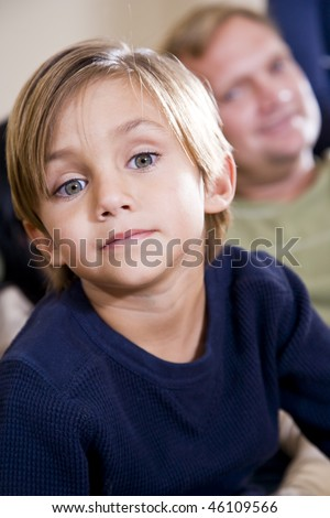 Face of cute 5 year old little boy with father watching in background - stock photo