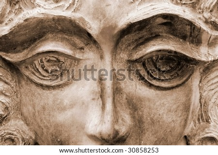 Face of female sculpture with bronze tone. - stock photo