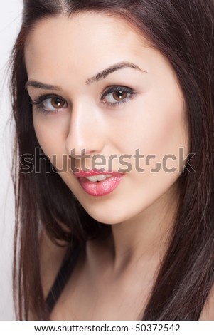 Face of fresh beautiful sexy young brunette