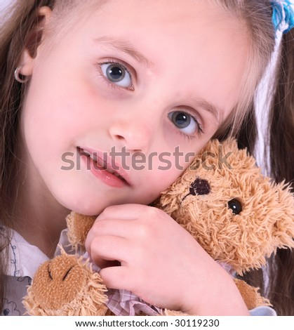 face of girl with toy