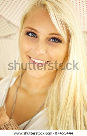 Face of glamorous young blonde lady with sparkling eyes exuding health and vitality. - stock photo